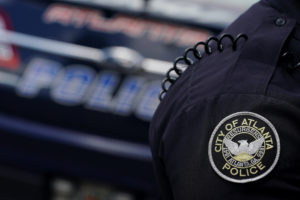 The Atlanta Police Department logo is seen on an Atlanta Police Department officer in Atlanta