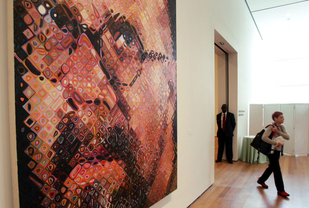 Chuck Close painting in newly renovated Museum of Modern Art in New York.