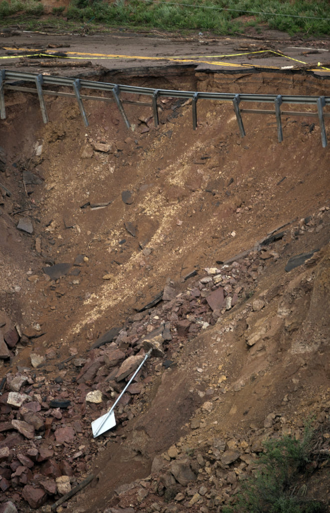 A damaged road is seen in Manitou Springs, Colorado