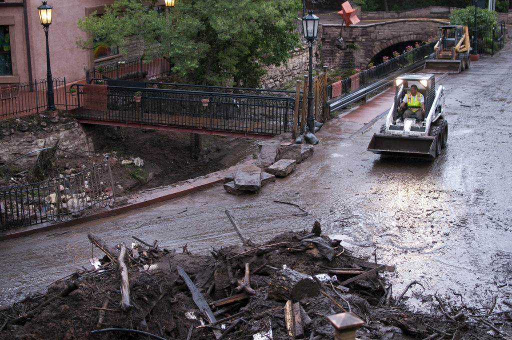 A street is cleaned up a day after a flash flood from the Waldo Canyon Fire burn scar swept through Manitou Springs