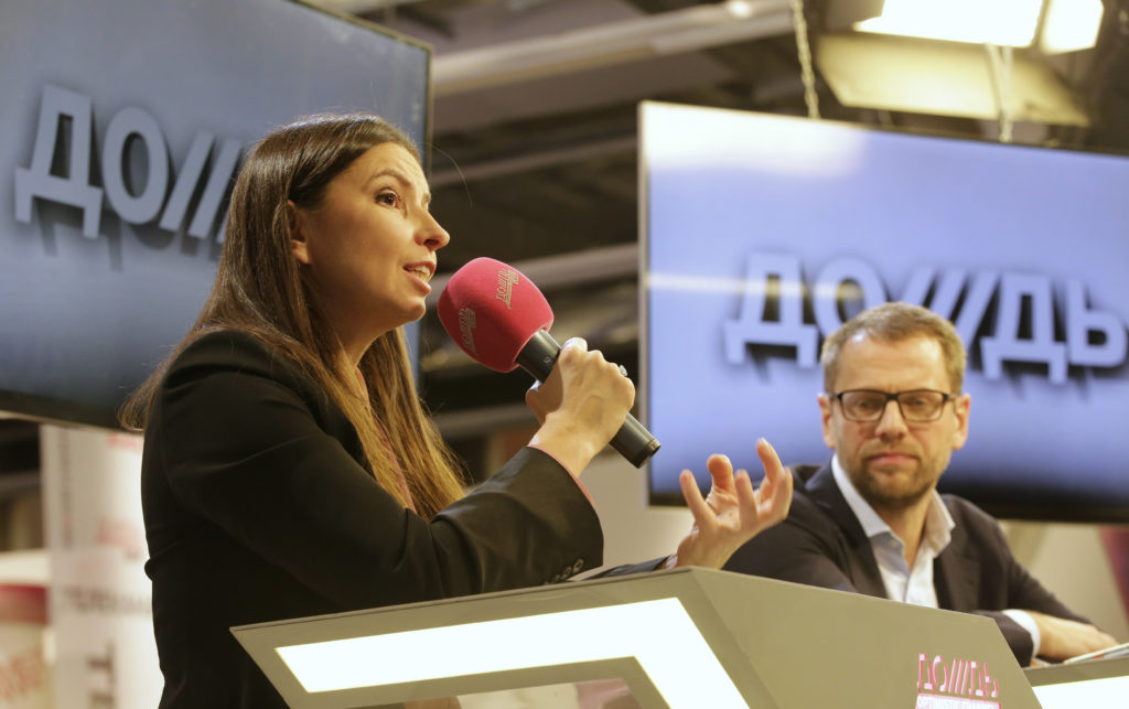 Sindeyeva, general director of Dozhd, and Vinokurov, the station's owner, take part in a news conference in Moscow