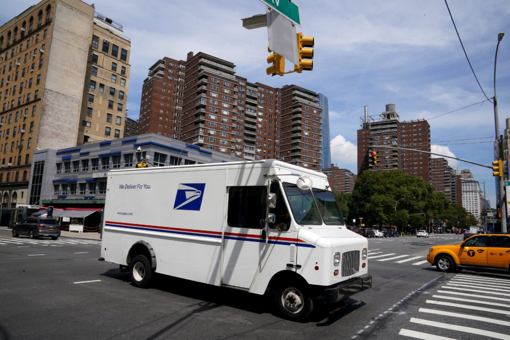 A U.S. Postal Service (USPS) truck is pictured