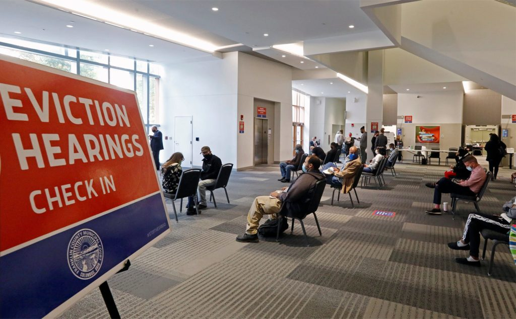 People wait for a eviction hearing at Franklin County Municipal Court in the Columbus Convention Center October 15,2020. With