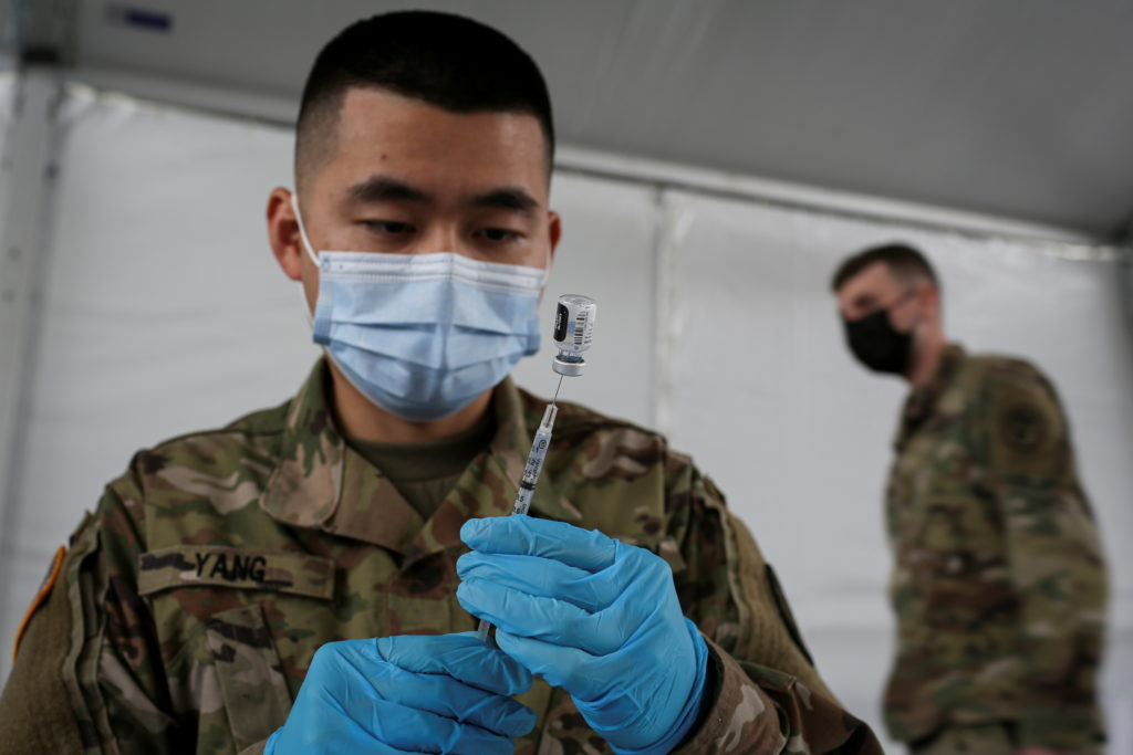 U.S. Army soldiers inoculate people with a coronavirus disease (COVID-19) vaccine in Miami
