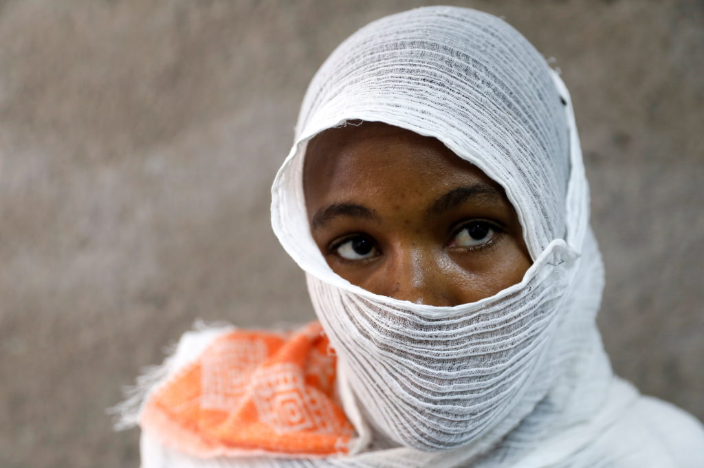 Ethiopian woman who says she was gang-raped by armed men is seen during an interview with Reuters in a hospital in the tow...