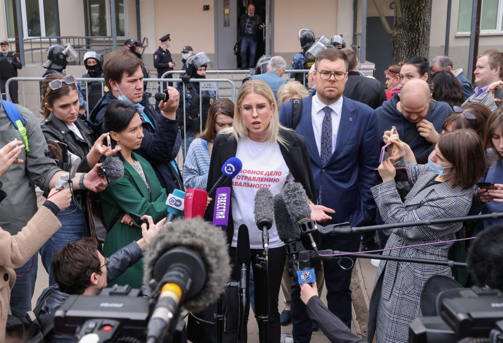 Russian opposition figure Lyubov Sobol speaks with journalists after a court hearing in Moscow