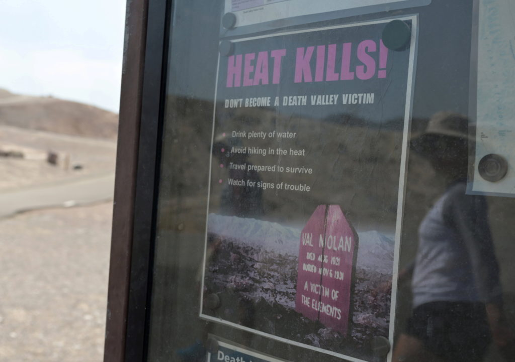 """A sign reads """"heat kills"""" in Death Valley"""