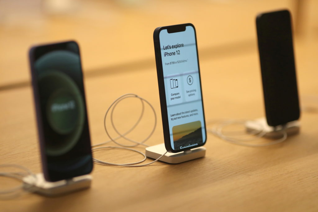 FILE PHOTO: IPhone 12 phones are seen at the new Apple Store on Broadway in downtown Los Angeles
