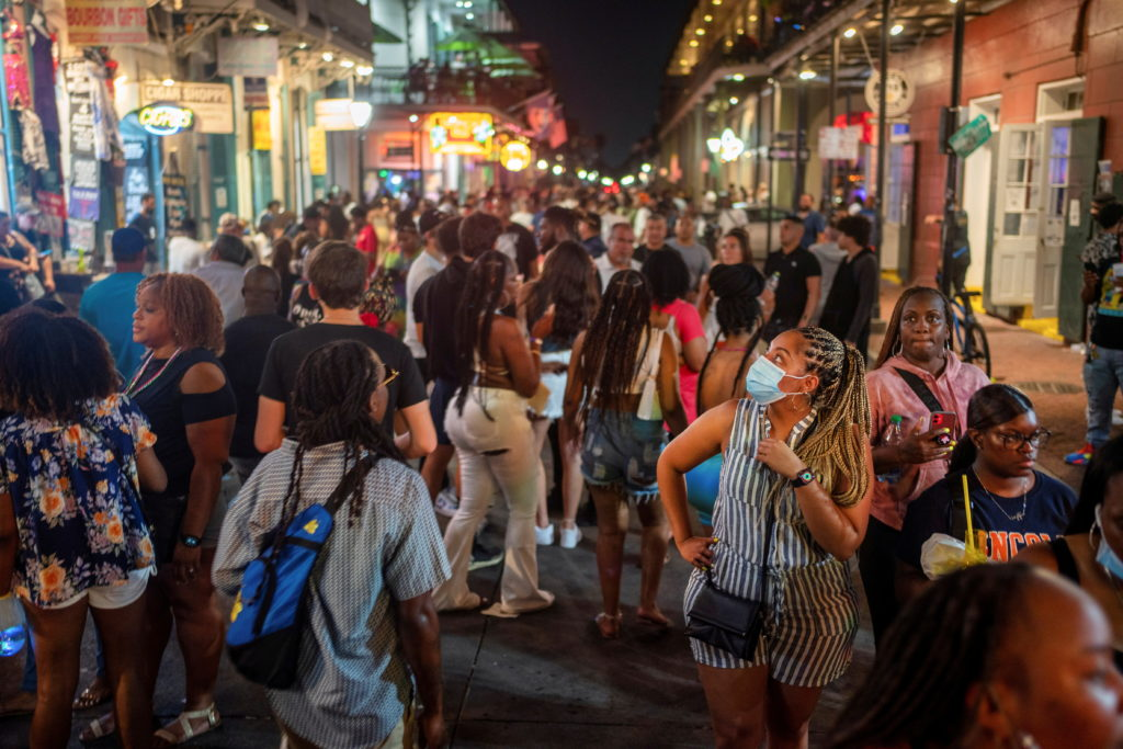 FILE PHOTO: Revelers crowd the French Quarter as Louisiana's COVID-19 cases rise amid Delta variant, in New Orleans