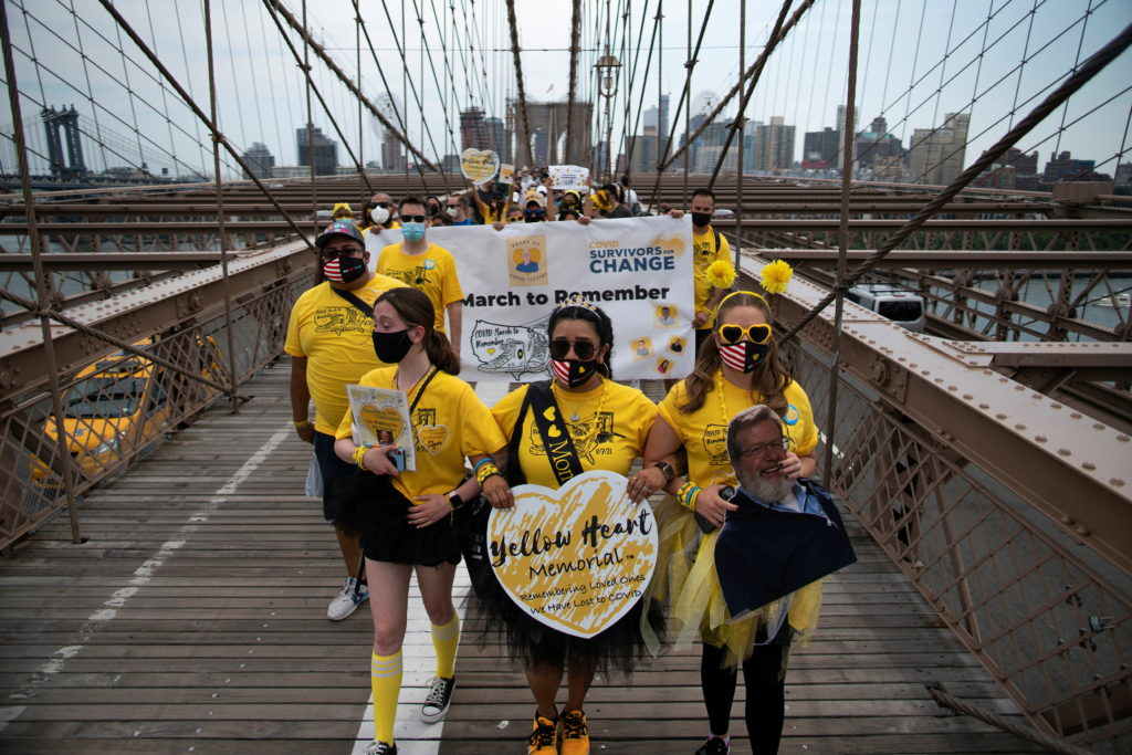 People walk across the Brooklyn Bridge together for those who were lost due to coronavirus disease (COVID-19) in New York