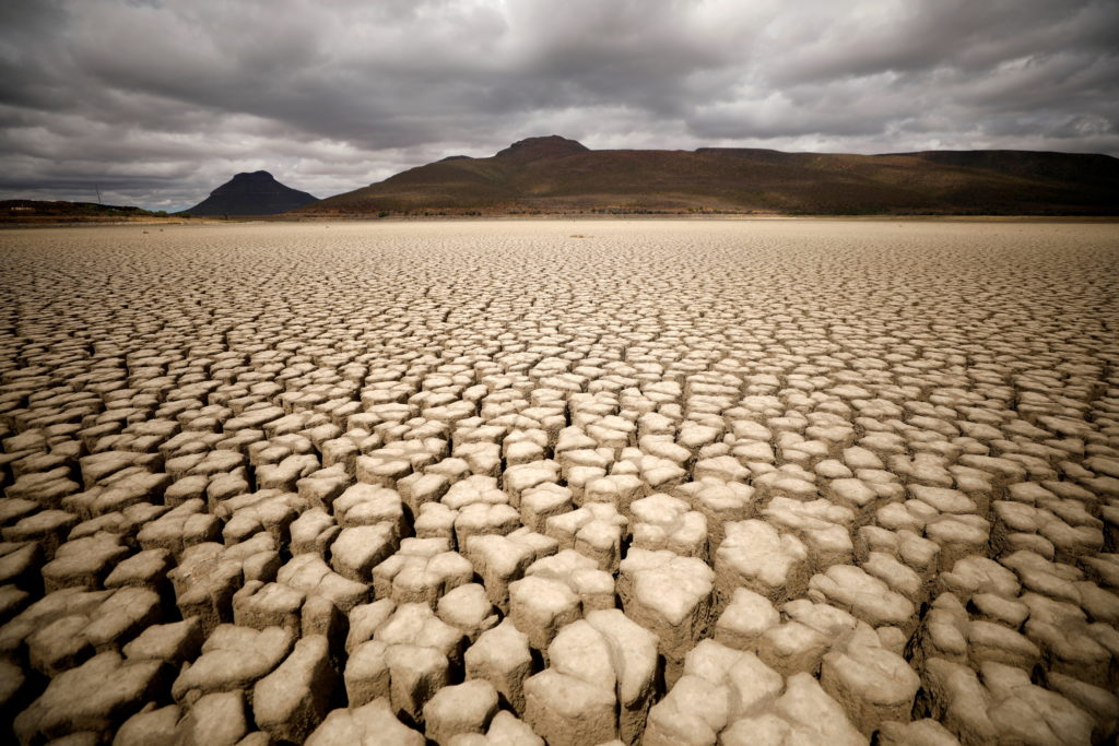FILE PHOTO: Clouds gather but produce no rain as cracks are seen in the dried up municipal dam in drought-stricken Graaff-...