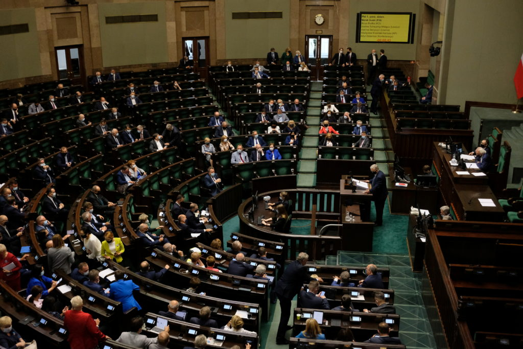 Lawmakers attend a session of the parliamentary commission on an amendment to the Broadcasting Act, in Warsaw