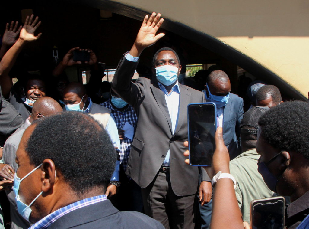 Opposition UPND party's presidential candidate Hakainde Hichilema waves to supporters after casting his ballot in Lusaka, ...
