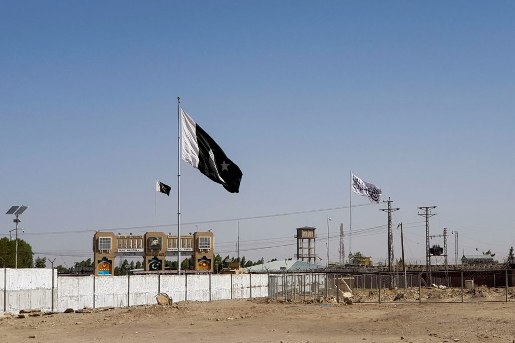 General view of the Pakistan's flag and the Taliban's flag in the background as seen from the Friendship Gate crossing poi...