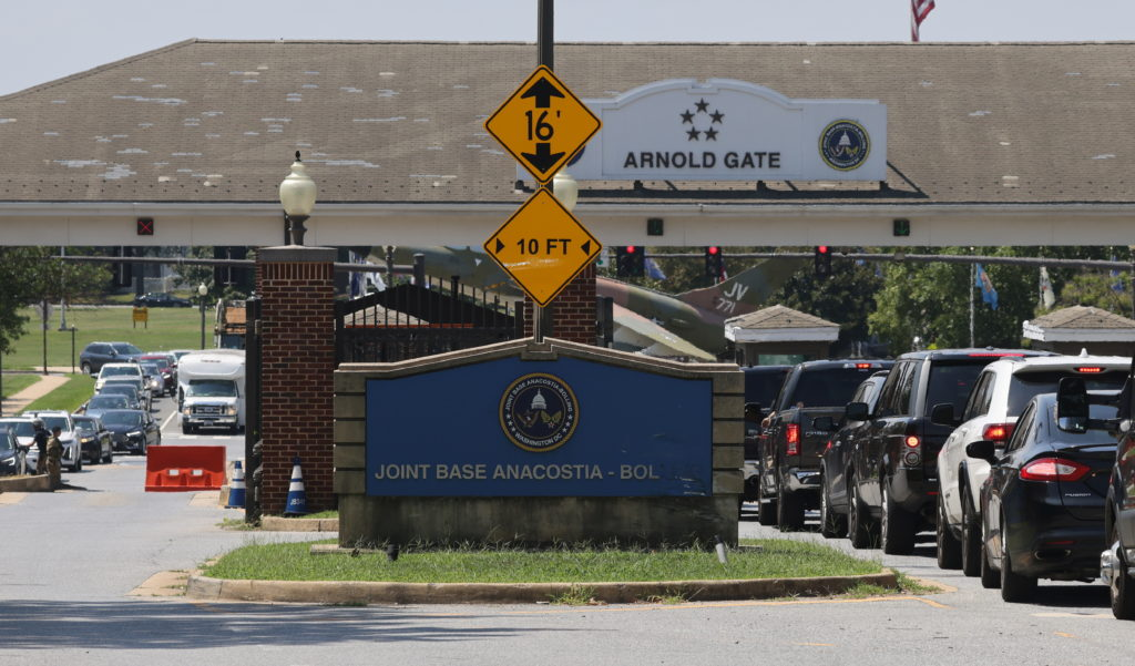 Traffic backs up at Joint Base Anacostia-Bolling after base was locked down due to a report of armed person in Washington