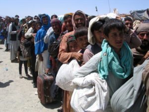 People wait to cross at Friendship Gate at Pakistan-Afghanistan border town of Chaman
