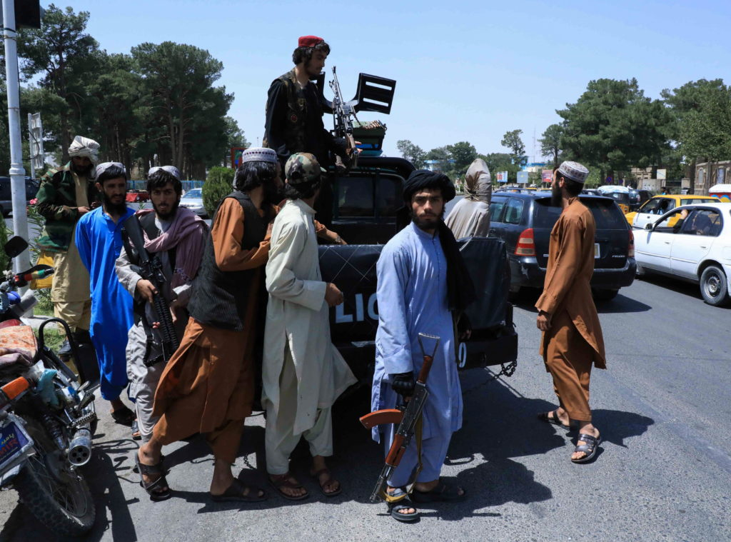 Taliban forces patrol a street in Herat