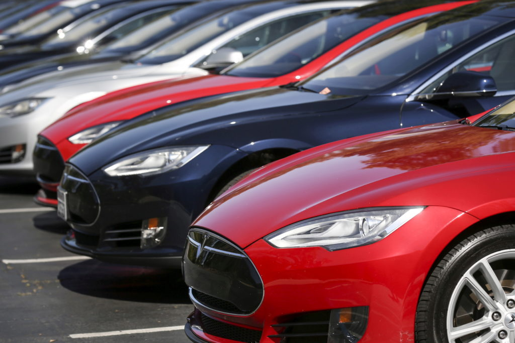 FILE PHOTO: Row of Tesla Model S sedans are seen outside the company's headquarters in Palo Alto, California