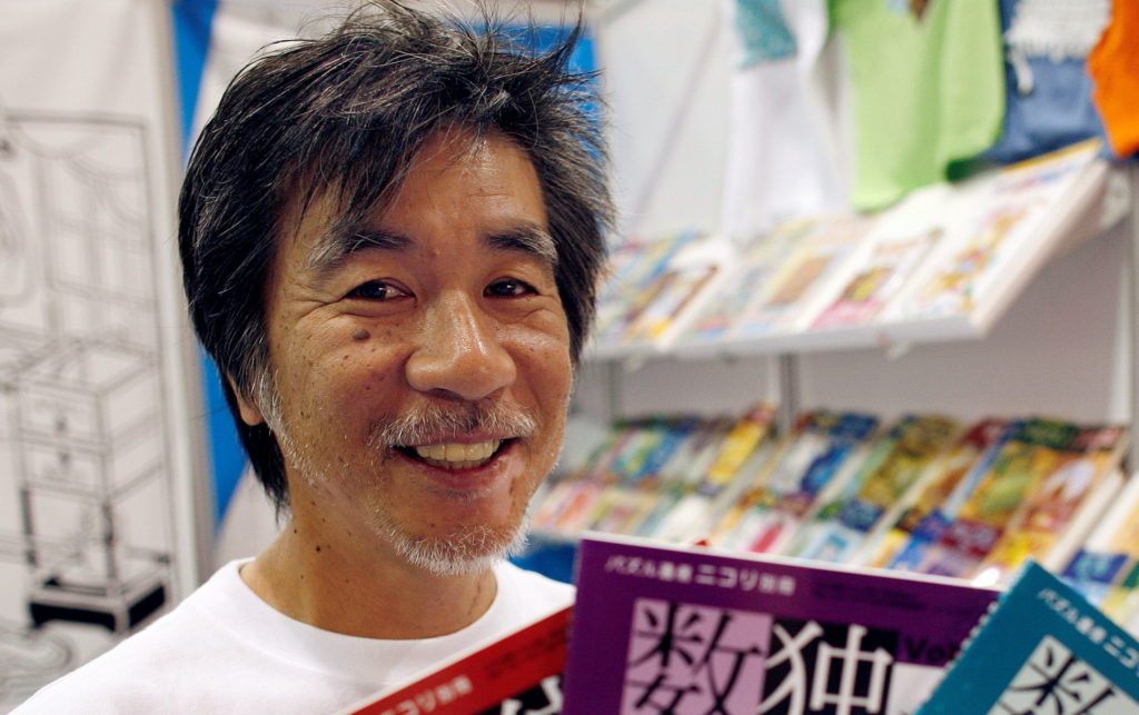 FILE PHOTO: 'Father of Sudoku' Maki Kaji holds copies of the latest sudoku puzzles at the Book Expo, in New York