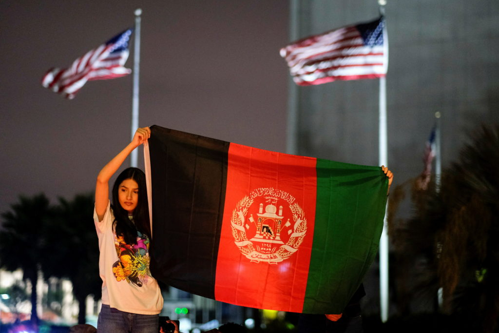 People attend a vigil for Afghanistan in Los Angeles