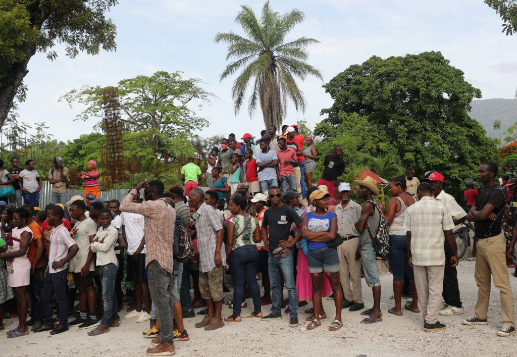 Camp Perrin residents receive food from the World Food Programme (WFP) in Camp-Perrin