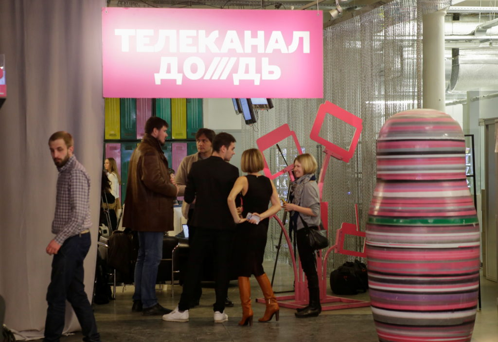 FILE PHOTO: Journalists chat in the offices of independent Russian news channel Dozhd (TV Rain) after a news conference in...