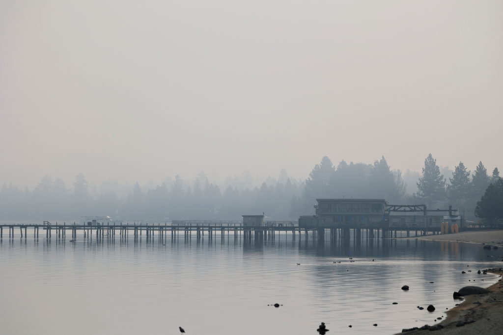 A view shows Lake Tahoe obscured by smoke from the Caldor Fire