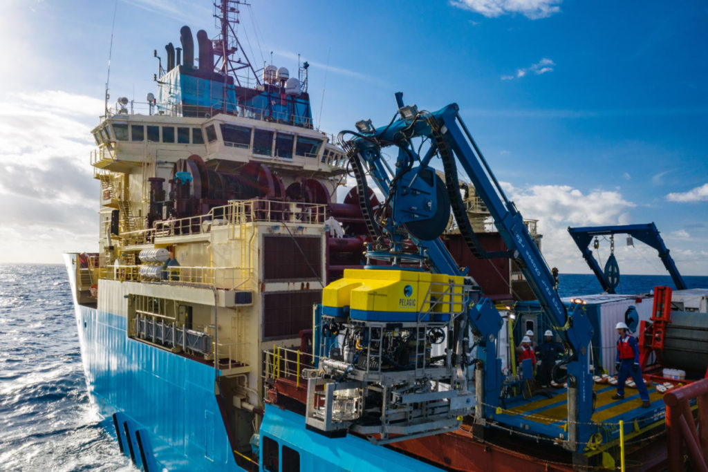 Researchers with DeepGreen Metals prepare to launch an autonomous underwater vehicle to survey ocean minerals aboard a research vessel.