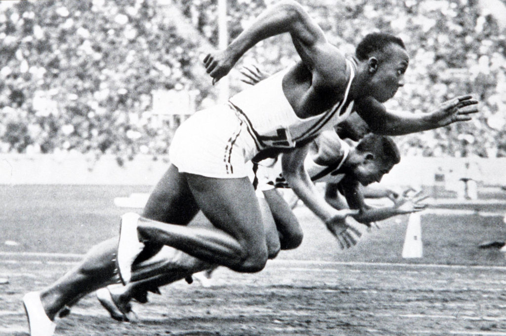 1936 Olympic Games. Berlin, Germany. Men's 100 Metres Final. USA's legendary Jesse Owens on his way to winning one of his ...