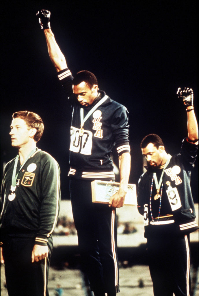 1968 Olympic Games Mexico City, Mexico. Men's 200 Metres Final. USA gold medallist Tommie Smith (C) and bronze medallist J...