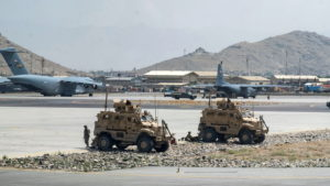 FILE PHOTO: U.S. Army soldiers assigned to the 82nd Airborne Division patrol Hamid Karzai International Airport in Kabul