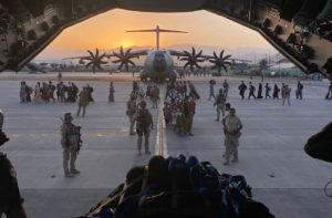 Afghan collaborators, their families, Spanish soldiers and members of the embassy board a Spanish military plane