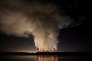 FILE PHOTO: Smoke and steam billows from Belchatow Power Station, Europe's largest coal-fired power plant operated by PGE ...