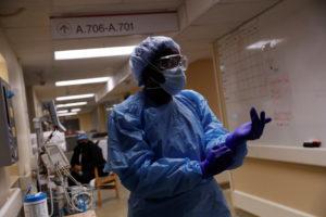 Registered nurse LaToya Marks prepares to treat a coronavirus disease (COVID-19) positive patient in Little Rock, Arkansas