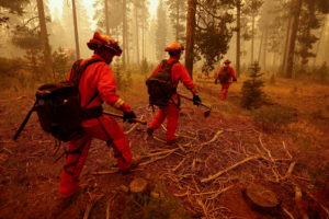 FILE PHOTO: Inmate firefighters watch for spot fires of the Dixie Fire in Westwood