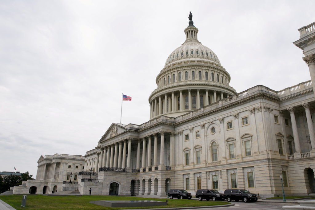 FILE PHOTO: Vehicles are parked outside the U.S. Capitol building the morning the Senate returned to session in Washington