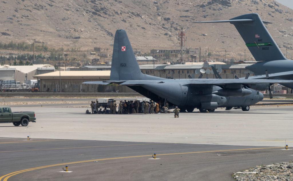 U.S. Department of Defense service members defend aircraft at Hamid Karzai International Airport in Kabul