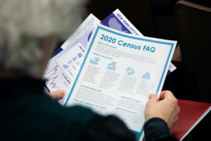 A person holds census information at an event where U.S. Rep. Alexandria Ocasio-Cortez (D-NY) spoke at a Census Town Hall ...