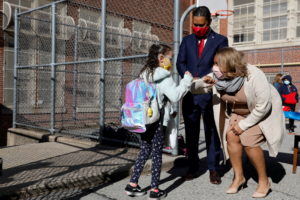 FILE PHOTO: Meisha Porter, Chancellor of the New York City Department of Education, greets students as they return to scho...