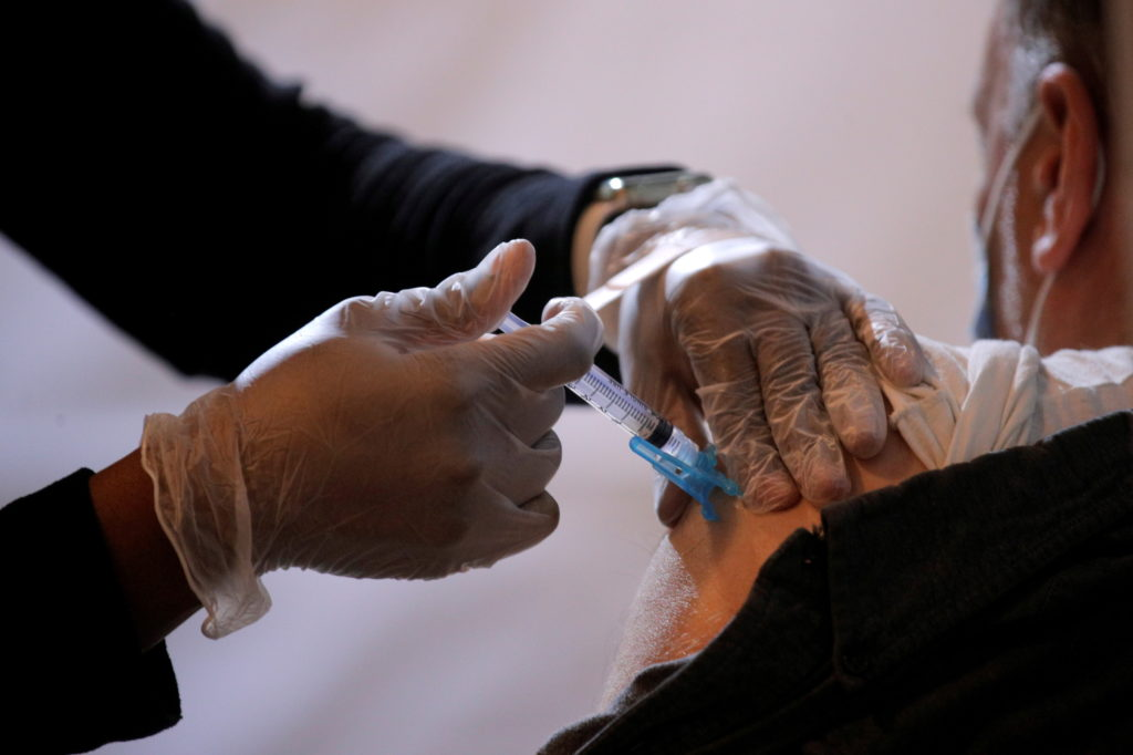 Commuter receives free vaccination for the coronavirus disease (COVID-19) at subway station in Brooklyn borough of New Yor...