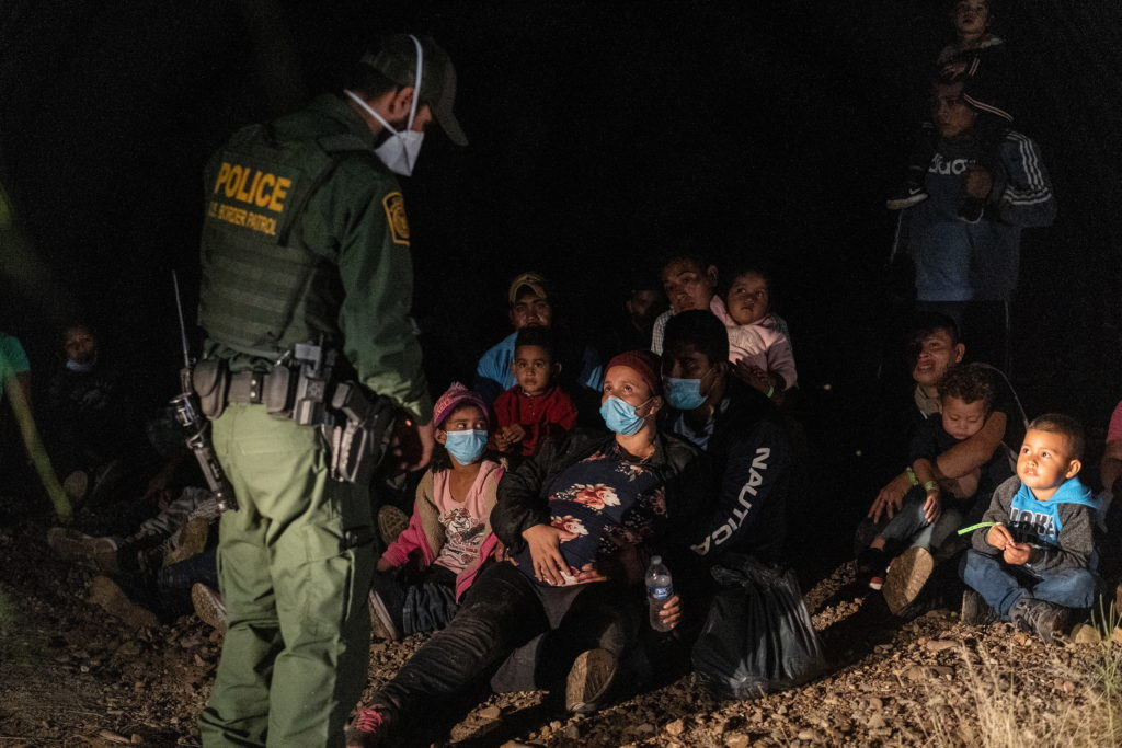 Asylum-seeking migrants cross the Rio Grande river in Roma