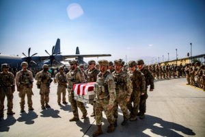 U.S. service members act as pallbearers for the service members killed in action in Kabul