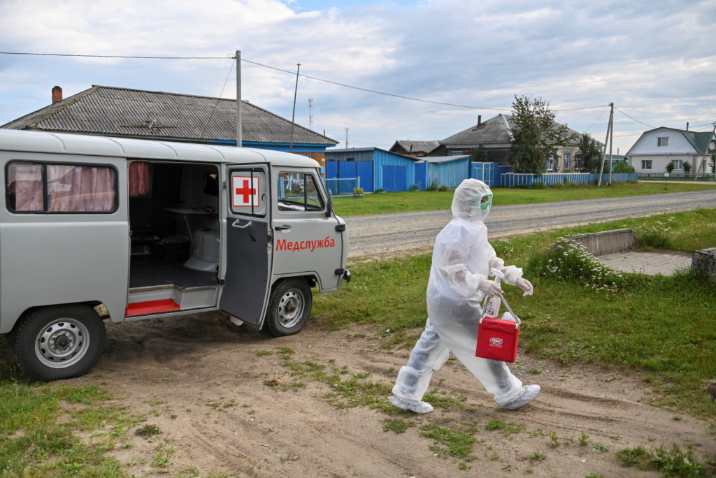 Paramedic Yulia Medvedeva wearing protective suit visits a COVID-19 patient in the village of Martyushevo, Omsk region