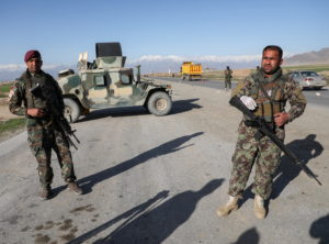 FILE PHOTO: Afghan National Army (ANA) soldiers stand guard at a check point near the Bagram Airbase north of Kabul, Afgha...