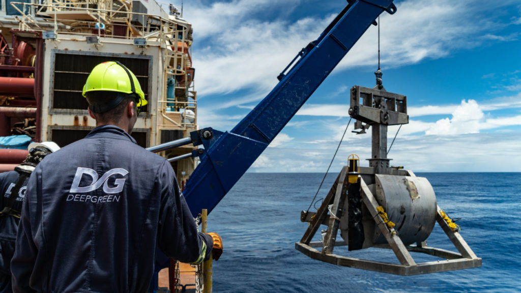 Researchers with DeepGreen Metals deploy a box core tool to capture a sample of the seafloor.