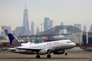FILE PHOTO: FILE PHOTO: A United Airlines passenger jet takes off with New York City as a backdrop