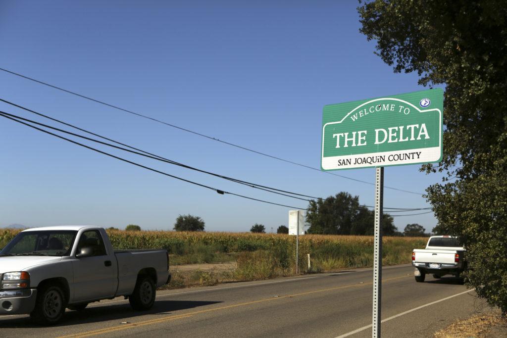A sign is shown in the Sacramento San Joaquin River Delta near Walnut Grove, California