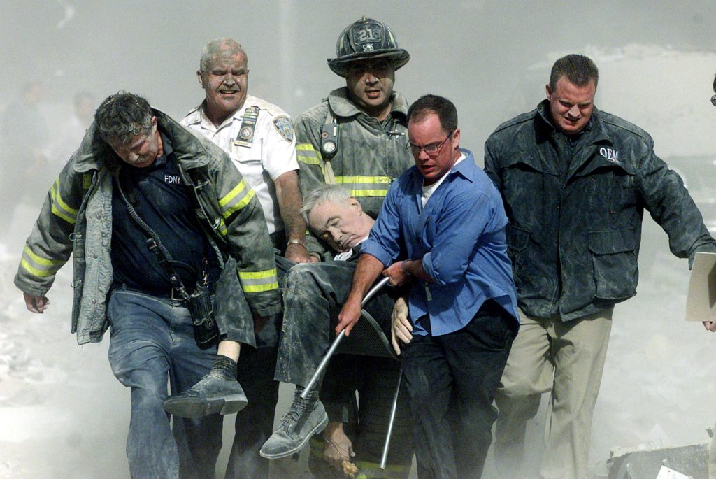 File photo of rescue workers carrying fatally injured New York City Fire Department Chaplain, Father Mychal Judge from the...