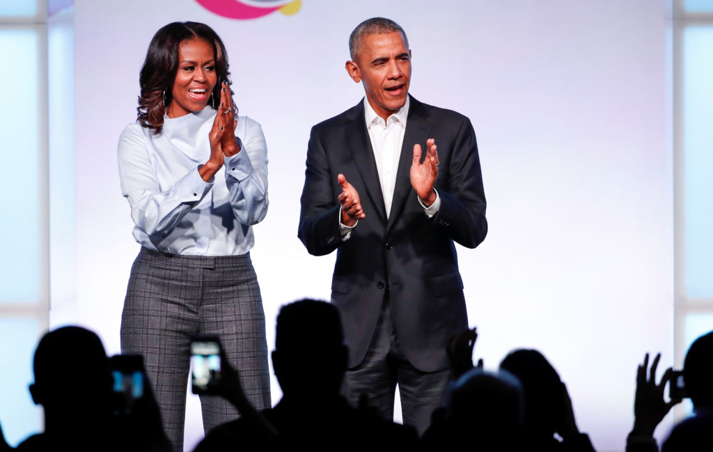 Former U.S. President Barack Obama and former first lady Michelle Obama arrive for the Obama Foundation Summit in Chicago