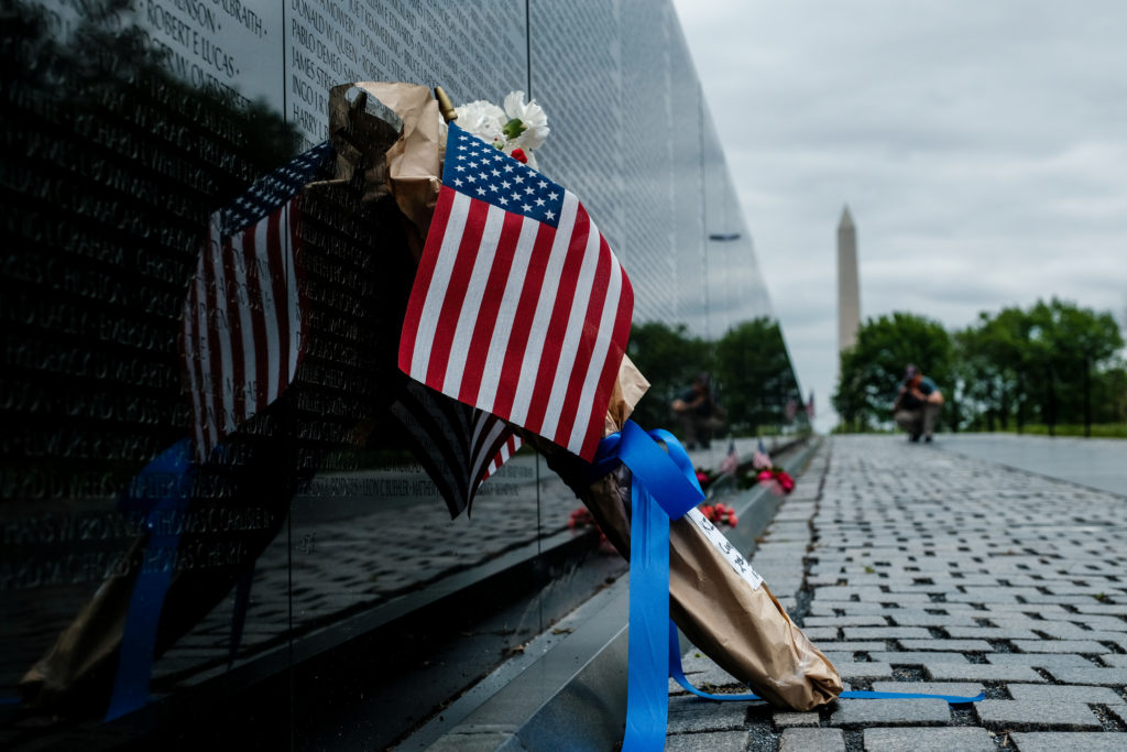 Flowers draped in flags have been left at Vietnam Veterans Memorial on U.S. Memorial Day holiday in Washington